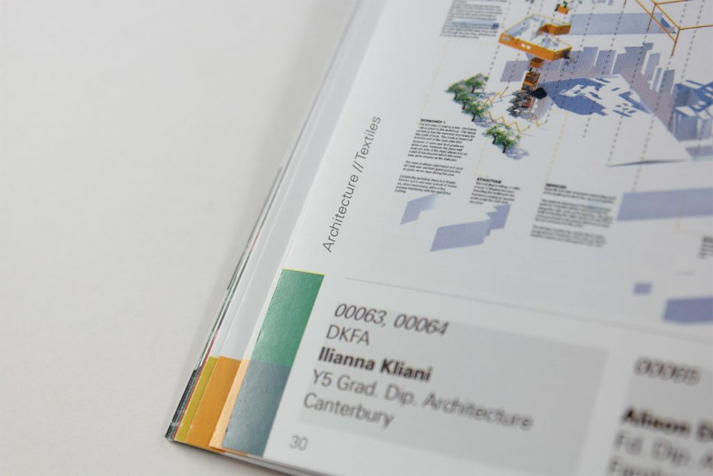 Close-up of glue magazine pagination with project categories and vibrant colour tabbing for navigation